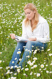 Beautiful woman reading a book outdoor Stock Photo