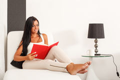 Beautiful woman reading a book Stock Photos