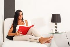 Beautiful woman reading a book Stock Photos