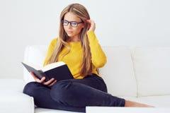 Beautiful woman reading book royalty free stock photo