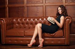 Beautiful woman reading a book Stock Image