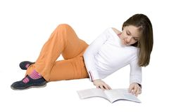 Beautiful woman reading on the floor Royalty Free Stock Photo