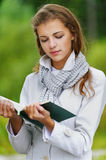 Beautiful woman reading green book Royalty Free Stock Photos