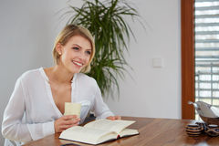 Beautiful Woman Reading Her Book Royalty Free Stock Photo
