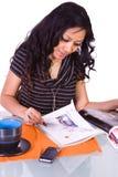 Beautiful Woman Reading a Magazine Stock Image