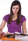 Beautiful Woman Reading a Magazine Royalty Free Stock Photography