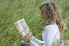 Beautiful Woman Reading Outdoors Royalty Free Stock Photography