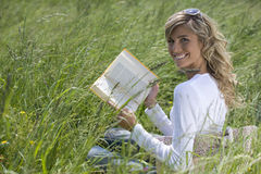 Beautiful Woman Reading Outdoors Royalty Free Stock Images