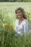 Beautiful Woman Reading Outdoors Stock Images