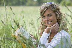 Beautiful Woman Reading Outdoors Stock Image