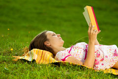 Beautiful woman reading in the park Stock Photos