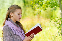 Beautiful woman reading red book Stock Photography