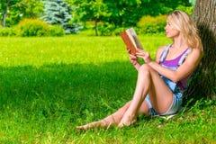 Beautiful woman reading a romance Royalty Free Stock Photography
