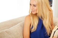 Beautiful woman reading on a sofa Royalty Free Stock Photo