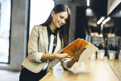 Free Beautiful Woman Reading The Menu On A Counter Royalty Free Stock Photo - 59927895