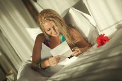 Beautiful woman reading valentine letter at morning. Stock Photo