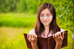 Beautiful woman reads book Stock Images