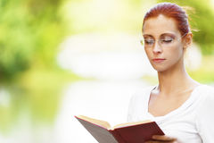 Beautiful woman reads book Stock Photo