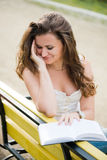 Beautiful woman reads a book Stock Photography