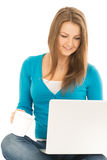 Beautiful woman reads news at laptop Royalty Free Stock Images