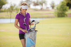 Beautiful woman ready to play golf Royalty Free Stock Photo