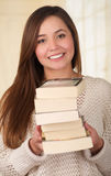 Beautiful woman ready to read a pile of books. Royalty Free Stock Images