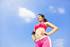 Beautiful Woman ready to start workout with music Royalty Free Stock Photography