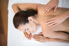 Beautiful woman receiving back massage Royalty Free Stock Image