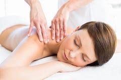 Beautiful woman receiving back massage Stock Image
