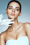 Beautiful woman receiving botox injection in cheek from beautician Royalty Free Stock Photos