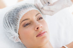 Beautiful woman receiving botox injection Royalty Free Stock Image