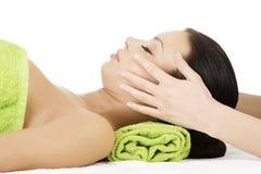 Beautiful woman receiving face massage. Beautiful young relaxed woman enjoy receiving face massage at spa saloon Stock Photo