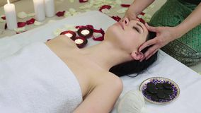 Beautiful Woman Receiving Face Massage in Spa. Beautiful young woman receiving face massage in spa, shallow depth of field, focus on hands stock video