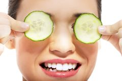 Beautiful woman receiving facial mask of cucumber Royalty Free Stock Photography