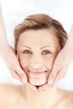 Beautiful woman receiving a facial massage Stock Images