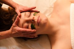 Beautiful woman receiving a facial massage in a spa. Royalty Free Stock Photo