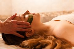 Beautiful woman receiving a facial massage in a spa. Royalty Free Stock Photography