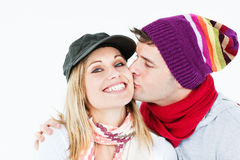 Beautiful woman receiving kiss from her boyfriend Stock Photography
