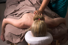 Beautiful Woman Receiving Massage 48. Beautiful woman receiving relaxing massage at home; woman is face down on table stock photography