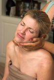 Beautiful Woman Receiving Massage 74. Beautiful woman receiving relaxing massage at home; woman is sitting up and getting a neck massage Stock Image