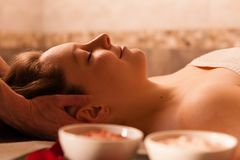 Beautiful woman receiving a massage in a spa. Stock Photos