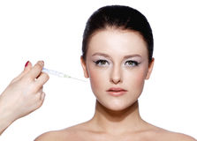 Beautiful woman recieving a botox injection Royalty Free Stock Photo