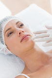Beautiful woman recieving botox injection Stock Photo