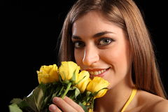 Beautiful woman recieving yellow rose flowers Stock Photos
