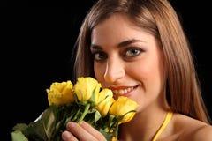 Beautiful woman recieving yellow rose flowers Stock Photos