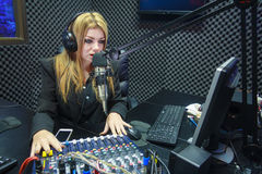 Beautiful Woman Recording Sound In Media Studio Royalty Free Stock Images