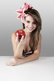 Beautiful woman with red apple Royalty Free Stock Photography