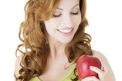 Beautiful woman with red apple. Stock Photo