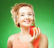 Beautiful  woman with red apple in hand Royalty Free Stock Photography