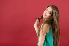 beautiful woman on red background Royalty Free Stock Images